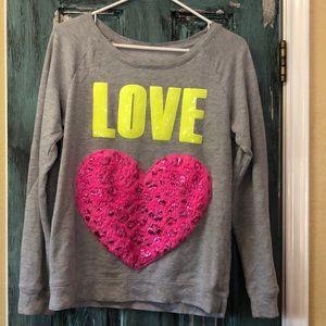 Justice Sequence LOVE sweatshirt.